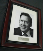 Photo in frame : Rev. Neil G. Price